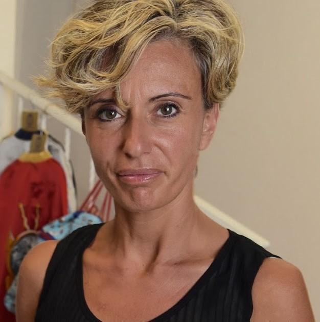 LAURA LARCAN